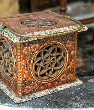 A painted antique wooden stove