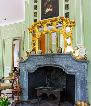 Old antique fireplace in the salon of Huize Boschoord